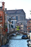 Venice Canal with two bridges and boats, with typical venetian architecture Royalty Free Stock Images