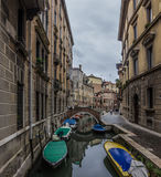Venice canal view. Venice Italy ,canal view with resting boats and ancient buildings Stock Photo