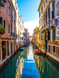 Venice canal. Venice water canal with old buildings and blue sky Stock Images