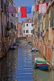 Venice, canal, water reflection and laundry hanging Royalty Free Stock Image