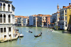 Venice Canale Grande. A very different of size boats and ships you can meet on Canale Grande in Venice. From historic very small and colourful gondolas to the royalty free stock photo