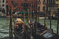 Gondolas in canals venice europe stock photos