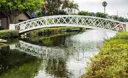 Venice Canals, white bridge - Venice Beach, Los Angeles, California. USA Royalty Free Stock Photo