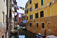 Venice. Cannaregio, Ghetto Ebraico. Dried dress over water canal in Jewish Ghetto. Tourists from all the world enjoy the historical city of Venezia in Italy Stock Images