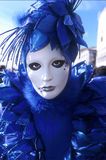 Venice Carnival. A head and shoulders portrait of a female dressed in a blue costume at the venice carnival Stock Photography
