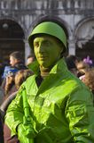 Venice carnival. February 2009. Great event in San Marco square. Green soldier Stock Photos
