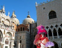 Venice carnival. Woman in red skirt Royalty Free Stock Photography