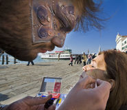 Venice carnival. Drawing on her face and joining people to the events in Venice. Carnival of Venice where you can be any mask royalty free stock photo