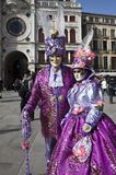 Venice Carnival 2011. VENICE - MARCH 1, 2011: An unidentified couple in bright costumes during Venice Carnival 2011, S. Marco square, Venice, Italy, March 1 Stock Photos