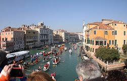 Venice carnival from the bridge 2019.Italy. NPeople enjoy watching a carnival from the bridge royalty free stock images