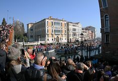 Venice carnival from the side. Next to the bridge.2019. Venice carnival from the bridge 2019.Italy.People enjoy watching a carnival from the bridge. Side view royalty free stock photo