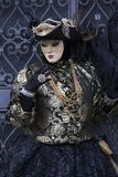 Venice Carnival Figures in black and gold costume and Venice Italy Royalty Free Stock Image