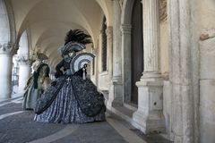 Venice Carnival costumes under the Arcade of the Doge`s Palace Venice Italy Royalty Free Stock Photography