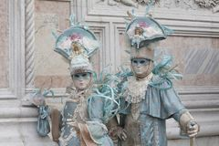 2 Venice Carnival Figures in a colorful costumes and masks Venice Italy Europe