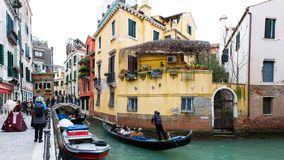 Venice carnival. Gondolas and tourists stroll through the canals of Venice during Carnival stock images