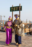 Venice 2017 Carnival, Italy. Colorful couple at the lagoon under Stock Photos