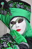 Venice Carnival. VENICE, ITALY - FEBRUARY 12: Carnival masked costume in green and black at the 2015 Venice Carnival:  February  12, 2015 in Venice, Italy Royalty Free Stock Image