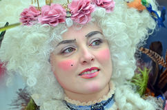 Venice Carnival. VENICE, ITALY - FEBRUARY 12: Pink flowers and powerdered wig at the 2015 Venice Carnival:  February  12, 2015 in Venice, Italy Stock Photos