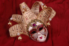 Venice carnival mask. On red sheet Stock Photography