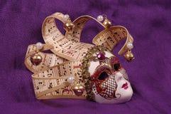 Venice carnival mask. On purple sheet Stock Photos