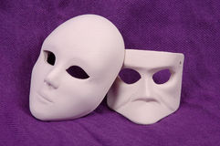 Venice carnival mask. Couple of Venice carnival mask on purple sheet Royalty Free Stock Images