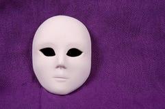 Venice carnival mask. On purple sheet Stock Image