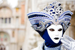 A venice carnival mask. A man in a blue and silver Venetian costume standing in St. Mark's Square, Venice Stock Image