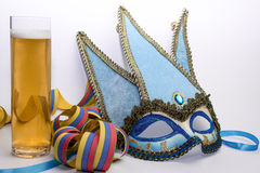 Venice carnival mask. Blue and golden venice carnival mask with german beer Royalty Free Stock Image