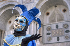 Venice Carnival Mask. A Jolly mask posing in San Marco Square, Venice, Italy Royalty Free Stock Image