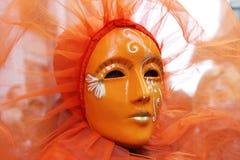 Venice Carnival Mask. Orange mask royalty free stock image