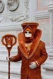 Venice Carnival Mask. Orange man stock images