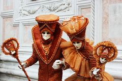 Venice Carnival Mask. Orange pair royalty free stock photography