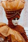 Venice Carnival Mask. Orange woman stock photography