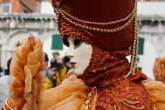 Venice Carnival Mask. Orange woman royalty free stock photo