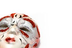Venice Carnival mask photographed with shallow depth of field and isolated on a seamless white background. As frame border and empty copy space. Concept for Royalty Free Stock Photography