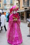 Venice Carnival Mask. Pink woman mask with flowers royalty free stock image