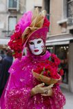Venice Carnival Mask. Pink woman mask with flowers royalty free stock photos