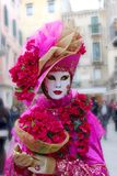 Venice Carnival Mask. Pink woman on street stock image