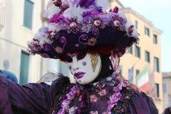 Venice Carnival Mask. Purple woman stock image