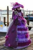 Venice Carnival Mask. Purple woman wear nice dress royalty free stock images