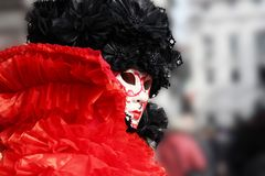 Venice Carnival Mask. Red and black woman mask stock photo