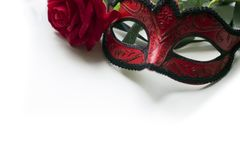 Venice carnival mask and red rose. On white background stock image