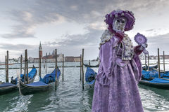 Venice Carnival Mask. Traditional mask in Venice, posing with a mirror during Carnival, Italy stock photography