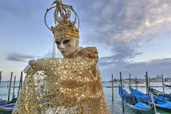 Venice Carnival Mask. Typical venetian mask posing at dusk during the Venice Carnival, Italy Royalty Free Stock Photo