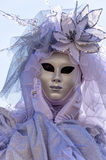 Venice Carnival Mask. A white/pink mask, posing in San Marco Square, Venice, Italy Stock Photos