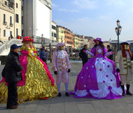 Venice carnival masked people. Disguised people at street during the Venice Carnival days.Venice Italy,Photo taken on February 8th,2015 Royalty Free Stock Photos