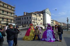Venice carnival masked people. Disguised people at street during the Venice Carnival days and tourists making snapshots.Venice Italy,Photo taken on February 8th Stock Photography