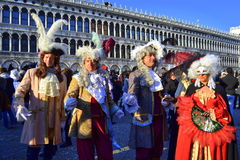 Venice Carnival masked people Stock Images
