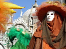 Venice carnival masks. Colorful carnival masks in Venice. On the background the Saint Mark's Basilica royalty free stock images