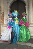 Venice Carnival Masks. Group of people wearing traditional venetian costumes during Carnival, Italy stock photo